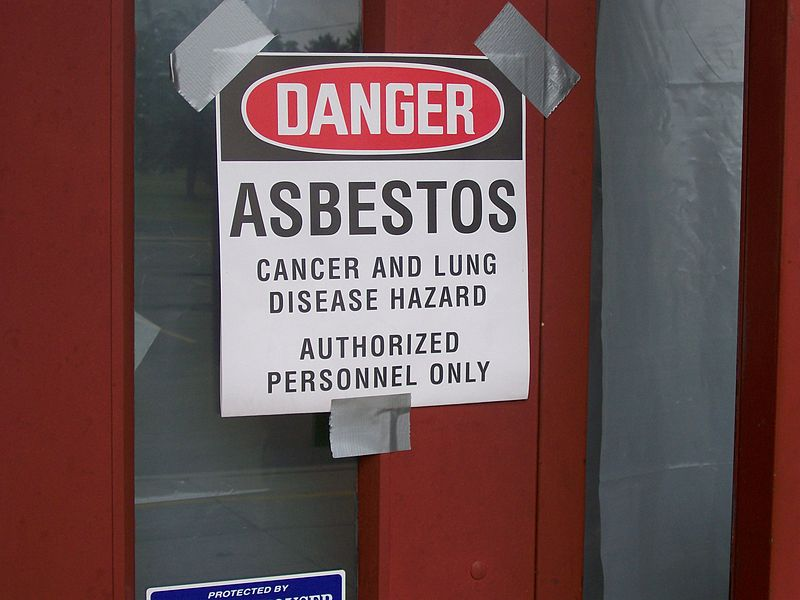 asbestos exposure warning sign at elementary school